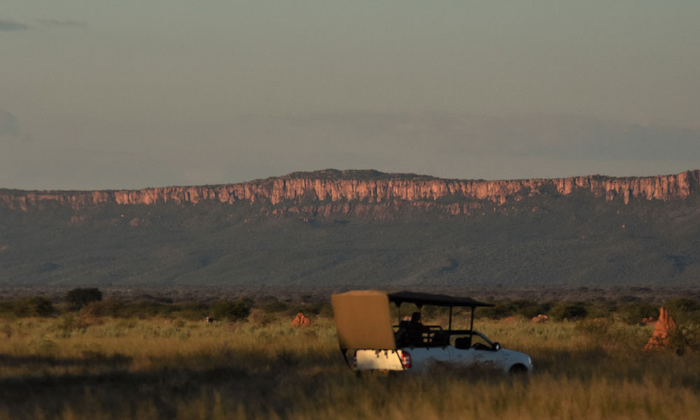Habitat Loss - Responsible Tourism CCF's truck in front of the Waterberg Plateau